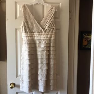 Sleeveless v neck champagne colored cocktail dress